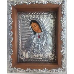 Cuadro de la Virgen de Gudalupe con metal repujado.